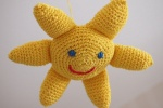 Virkattu aurinko vauvalle leluksi